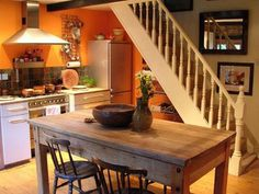 orange kitchen walls and light wood cabinets | our future home
