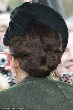 Kate kept her hair tied in an elegant chignon  as she attended a Christmas Day church service at Sandringham on December 25, 2015 in King's Lynn, England.