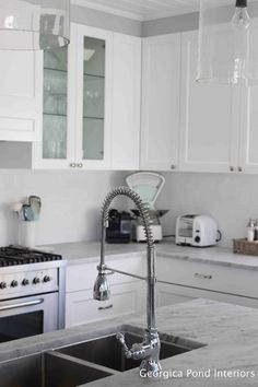 White shaker cupboards, marble-looking type countertops, espresso island Love the faucet too Hamptons Style Homes, Kitchen Remodel, Kitchen Taps, Hamptons Kitchen, Kitchen, New Kitchen, Home Kitchens, Kitchen Styling, Kitchen Living