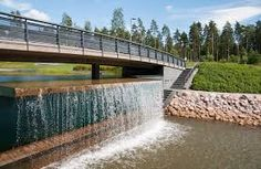 Uutelan kanava. Waterfall & bridge. A new neighborhood in Helsinki. Aurinkolahti / Vuosaari. Close to a beach and trails
