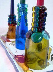 If you are looking for a cool and creative way to spice up your evening meal, try creating these Tuscan Lights Candlesticks, which are both beautiful and easy to make. Plus, these easy candlestick crafts are made from recycled bottles. Wrapped Wine Bottles, Old Wine Bottles, Wine Bottle Candles, Recycled Wine Bottles, Wine Bottle Corks, Glass Bottle Crafts, Bottles And Jars, Bottle Lights, Glass Bottles