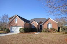 All brick one story home! Great lot overlooking scenic pond! This updated open floor plan features hardwood floors in the living areas and ceramic tile in the baths.  The spacious great room offers a vaulted ceiling, cozy fireplace with gas logs and a wall of windows overlooking the pond. In the kitchen you will find custom cabinetry, gorgeous granite countertops, tile backsplash and stainless appliances to include refrigerator. Off the kitche...