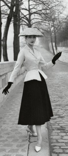 'Bar' is one of the most important designs from Dior's first collection. The tight-fitting jacket has padded hips which emphasise the tiny waist. The long pleated wool skirt, backed with cambric, is exceptionally heavy.