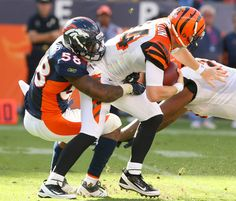 Linebacker Von Miller sacks Bengals quarterback Andy Dalton on Sept. 18, 2011. (Gabriel Christus 2011)