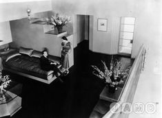 The floors were covered in black rubber submarine flooring polished to a high luster (like one of his sets for a big dance sequence) and all the door surrounds had the same asymmetric treatment... OOH--and satin upholstery--so smart! so 30s!