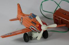 Vintage Tin Litho Marx Orange Fighter Airplane Battery Operated Remote Controlled Toy