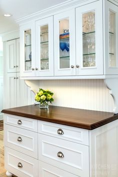 a beach cottage kitchen cabinetry woodmode brookhaven cabinets with nordic white finish countertops