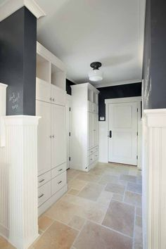 mud room. I love the chalkboard paint on the accent walls, but I would insist that a drain be added in the middle of the floor. What good is a mud room if you can't hose it down quickly?