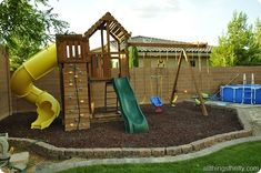 Mulch wood, wooden playset, swings, plastic slide and loads of fun ...