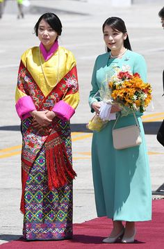 Japanese Princess Mako (R), the first grandchild of Emperor Akihito, poses for photos with Bhutan's Princess Eeuphelma Choden Wangchuck (L) at Paro International Airport near Bhutan's capital Thimphu, on June 1, 2017 upon her arrival for a nine-day visit.