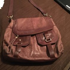 The Sak brown leather purse. The Sak brown leather purse. Well loved with life left. A little dark on the back from resting against clothing. Front inside lining pocket has a hole in the inside only. Priced according to condition. The Sak Bags Crossbody Bags