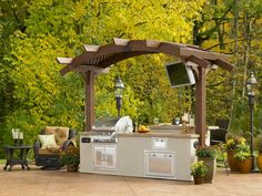 Small Outdoor Kitchen Island With Arbor And LCD TV