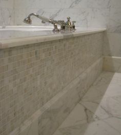 Love the tile instead of cabinetry around the tub.