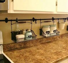 By hanging curtain rods and holders, you're able to eliminate the clutter on your kitchen counter. Easy clean ups! Small Kitchen Organization Ideas