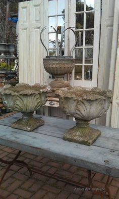 Great pair of Garden Urns/ I have two of the exact urns. I placed beautiful rize. - Great pair of Garden Urns/ I have two of the exact urns. I placed beautiful rizers under them to gi - French Decor, French Country Decorating, Casa Magnolia, Urn Planters, Cement Planters, Garden Urns, Garden Ornaments, Garden Inspiration, Flower Pots