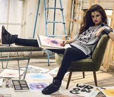 Kicking back: Selena looked happy and relaxed as she sat back and relaxed with her pencil and pad