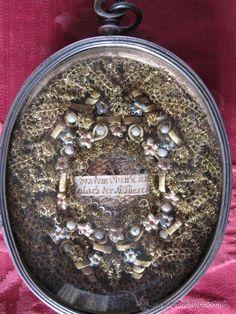 Relicario de plata y bordados de santa Teresa de JHS.