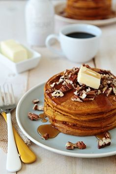 Topped with fresh maple syrup and a nutty crunch from walnuts, these Pumpkin Pancakes are perfect for fall. Whether you choose to serve these pancakes to friends at brunch or to wake up your family with the cozy aromas, they're sure to be a hit. Pumpkin Pancakes, Pancakes And Waffles, Pecan Pancakes, Buttermilk Pancakes, Pumpkin Recipes, Fall Recipes, Pecan Recipes, Breakfast Dishes, Breakfast Recipes