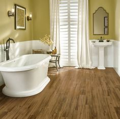 The good thing about Armstrong's luxury vinyl products is they are completely waterproof.  Arbor Orchard Apple Cider can even be installed in a bathroom!  http://www.truehardwoods.com/product/armstrong-luxury-vinyl-vivero-intergrilock-better-u4011-arbor-orchard-apple-cider/