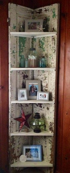 My first DIY creation. Old door from the Flea market for $20. Scrapped the white paint and found beautiful colors underneath. Thanks to Dad for being quite handy and creating my corner shelf! Love it!