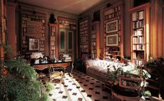 Barbara Wirth's place du Palais Bourbon apartment.  The green-and-pink library, with its strong English influence contains an 18th-cen...