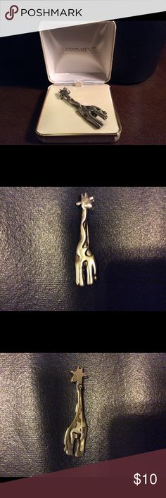 Vintage pin. Vintage giraffe pin in original box.  Investments brand sold through Dillard's.  The pin is a combination of gold and silver color.  The design is unusual.  The base of the giraffe is gold color with a top layer of silver color with cutouts for the gold color to appear as the spots on the giraffe. Jewelry Brooches