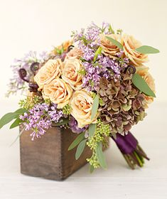 With paler roses, or even purple roses, this bouquet would be perfect - I love the purple hydrangeas and lilacs (though lilacs may not be avail in Nov) (From real simple: The hearty hydrangea can fill up a bouquet quick. Add in a mix of other blooms and natural elements like roses, lilacs, eucalyptus, and fern fronds, to cast an antique autumn feel.)