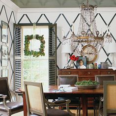 Make Your Own Magnolia Wreath   A traditional element in all Southern Christmas decorating, the magnolia wreath is given a modern makeover with a square shape.                                            Wide white ribbon keeps the embellishment to a minimum and the focus on the room's tall, paned windows