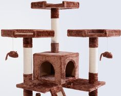The Frisco 72-Inch Brown Cat Tree is the ultimate all-in one spot for your kitty to do all the things she loves, from lounging to leaping to honing her expert hunting skills. Frisky cats can jump from perch to perch as they climb to the top of their lookout tower. Carefully placed dangling toys give kitty the thrill of the hunt as she bats them around till her heart's content. With 10 enticing scratching posts and two scratch board ramps, several cats can claw at once, so it's great for multi... Lookout Tower, Cat Tree Condo, Brown Cat, Scratching Post, Bar Stools, Cats, Maruchan Ramen, Faux Fur, Gatos