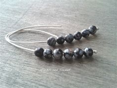 Snowflake obsidian threaders. Long thin black volcanic glass threader earrings in recycled sterling silver by Harsh and Sweet.