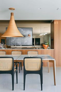 This kitchen has a Japanese feel and I love the way the hanging pendant is made with a texturous balsa wood, it pulls in all the other natural textures and elements of this room.