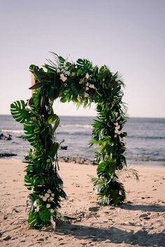A dramatic palm frond arch, a Costa Rican jungle hut, all white bridesmaid dresses... this intimate beach wedding is a tropical bohemian mood. We adore the laidback energy of the day, as evidenced so beautifully in the Golden Hour newlywed portraits by the ocean, her loose open back gown flowing romantically in the wind. See this Costa Rica micro wedding in full on the blog! Ceremony Backdrop, Ceremony Decorations, Wedding Ceremony, Indoor Wedding, Garden Wedding, Backdrops, Backdrop Ideas, White Bridesmaid Dresses, Palm Fronds