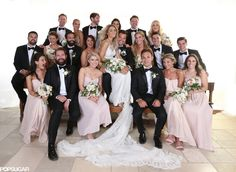 I like this wedding party picture with the bride sitting on the groom's lap and everyone gathered around.