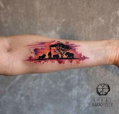 Animals of Africa silhouette watercolor piece on girl's forearm. Tattoo by Koray Karagozler, an artist based in Antalya, Turkey.