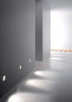 White corridor with recessed mounted light in white metal by Oty Light _