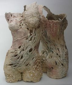 Pauline Lee: Stoneware clay textured with plant material and moulded into hollow forms.