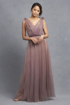 For the perfect mix of modern and vintage wedding style, go for a mauve bridesmaid dress with an illusion neckline to create a timeless look.