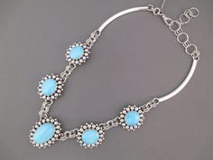 BEAUTIFUL Necklace of larger Sleeping Beauty Turquoise stones surrounded in sterling silver dots. Made by Navajo jewelry artist, Artie Yellowhorse. STUNNING