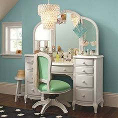 Adding a white vanity. I would put my makeup, perfumes, and smaller candles there. The chair matches my room and I love the mirrors and drawers.