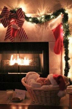 newborn baby near fireplace decorated for Christmas, low light using only stringed Christmas lights