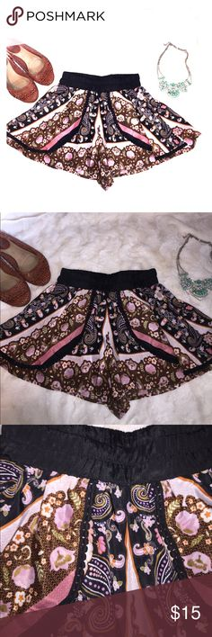 Flowy shorts with crochet accents Like new preowned condition. Boho chic style! Black thick gathered elastic waistband. Wide legs that make the shorts flowy and skirt like. Black crochet accent down the front. Brown, black, orange, olive green and dusty rose pink colors. From a smoke free and pet free home Band of Gypsies Skirts Mini