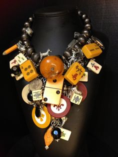 Game On  A  statement necklace of antique and vintage game pieces...wearable art. $485.00, via Etsy.