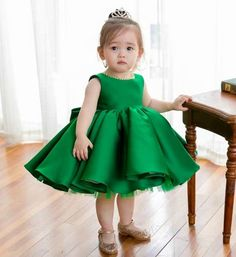 Big Bow Ruffles Dress--Made To Order - High Quality Beautiful Round Neckline Sleeveless Knee Length Big Bow Back Infant Toddler Little & Big Girl Party Ruffle Dress. Available from Newborn - 15 Years. Material: Satin, soft polyester fiber, purified cotton lining, tulle mesh. Color: Emerald Green, Royal Blue, Rose Red. Please do compare your little girl measurements with our size chart before deciding her size or you may leave a note your little girl's height, bust and waist size.