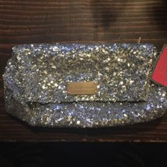 VICTORIA'S SECRET Silver Sequined Clutch NWT. VICTORIA'S SECRET. Body By Victoria, Silver Sequin Clutch. Super cute clutch or make up bag cute carryall. Covered in silver sequins. None missing. GOLD PLATE says VICTORIA'S SECRET. Black satin on inside. Back zipper on back of clutch zips to the inside of the purse. Super convenient. Victoria's Secret Bags Clutches & Wristlets