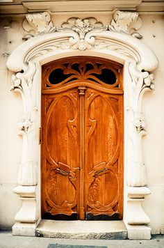 Arched portal, wood carved doors, Paris, France