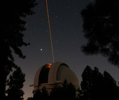"""Palomar Observatory. The adaptive optics system uses a laser star as a calibration source and then deforms a small mirror to correct for distortions caused by the atmosphere. The corrections are made faster than the atmosphere can change -- thousands of times per second. Mona Evans, """"Palomar Observatory"""" http://www.bellaonline.com/articles/art66984.asp"""