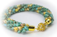 Lovely seed beaded bracelet available in all sizes. Made with Japanese premium class magatama beads of turquoise gold colour. Decorated with rhinestone strong magnetic clasp. 100% HANDMADE using ancient Japanese art of braided jewelry called Kumihimo gives this bracelet a scale-like outfit. This is an unique and inimitable style of serpentine braided jewelry also reminds a dragon tail. ✿ Details ✿ Available: 3-5 business days Size: all sizes available see chart below Colour: turquoise gold…