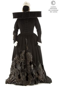 "Thierry Mugler, costume for the first witch, latex appliqués with ""burnt"" effect on the skirt, pleated satinette ruff, from Shakespeare's Macbeth, Carlo Tommasi, 1985"