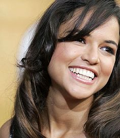 She puts down one heart-stopping tough taco, but when she smiles it's all feminine beauty and grace. Michelle Rodriguez