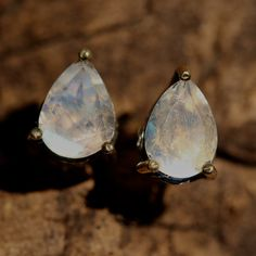 Pear faceted moonstone earrings in silver and brass prongs setting with sterling silver post and backing